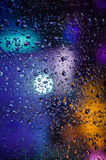 Drops of night rain on window, abstract background Stock Images