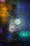 Drops of night rain on window, abstract background Stock Photo