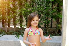 Free Drops Of Water Fall On Little Girl In Swimsuit Shower On Sunny Day Outside Stock Photos - 109971123