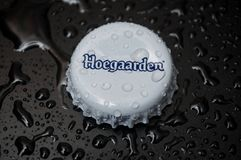 Free Drops Of Water On Metallic Cap Of Bier By Hoegaarden Brand On Black Background Stock Photography - 165363132
