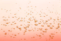 Drops on the orange mirror surface. selective focus Royalty Free Stock Image