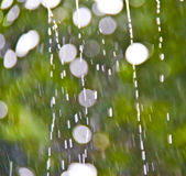 Drops of rain with abstract lights Stock Photography