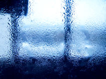 Drops of rain on blue glass background Stock Images