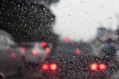 Drops of rain on car's mirror Stock Photography