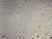 Drops of  rain   covering  transparent car  glass royalty free stock images