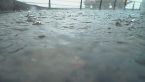 Drops of rain on the deck of a ship docked in the port gloomy, rainy weather stock video footage