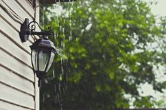 Drops of rain fall on the lantern stock images