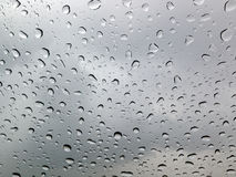 Drops of rain on the glass. Many drops of rain on the glass Royalty Free Stock Photo
