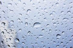 Drops of rain on glass , rain drops on clear window. Stock Photos