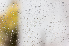 Drops of rain on glass , rain drops on clear window. Drops of rain on glass , rain drops on clear window Royalty Free Stock Image