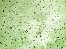 Drops of rain on glass , rain drops on clear window / rain drops with clouds / water drops on glass after rain background / water. Drops Royalty Free Stock Images