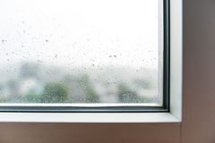 Drops of rain on the inclined window (glass) Royalty Free Stock Photo