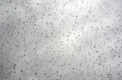 Drops of rain on the inclined window (glass) Stock Images