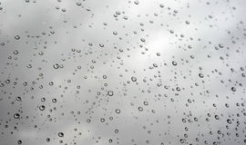 Drops of rain on the inclined window Royalty Free Stock Photos