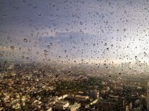 Drops after rain. Lots of drops on the glass of a high building in Bangkok Stock Photography