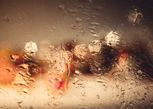 Drops Of Rain wiht Street Bokeh Lights Out Of Focus Autumn Abstr Royalty Free Stock Images