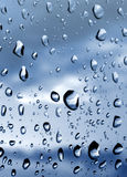 Drops of rain on the window. Drops of morning dew on the window Royalty Free Stock Images