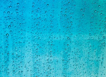 Drops of rain on a window glass. Rain drop on auto glass in rainy day royalty free stock images