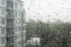 Drops of rain on a window pane. Stock Photos