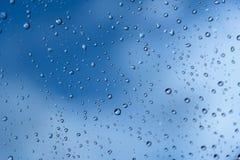 Drops of rain on a window pane. Shallow depth of field. Selectiv Stock Photo
