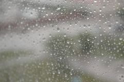 Drops of rain on the window, rainy day Stock Images