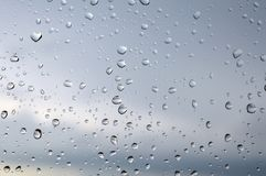 Drops of rain on the window Stock Images