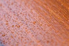 Drops of rain on wood. Morning drops of rain on wood royalty free stock photo