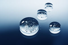 Drops on reflecting surface Royalty Free Stock Photography