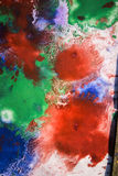 Drops with streaks of different colors paint are mixed Royalty Free Stock Photos