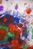 Drops with streaks of different colors paint are mixed Royalty Free Stock Images