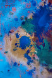 Drops with streaks of different colors paint are mixed and absorbed Royalty Free Stock Image
