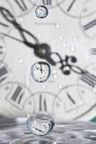 Drops of time. Drops of time a'la Salvador Dali. Play with water and clocks Royalty Free Stock Photo