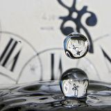 Drops of time. Here are the pure drops of water, the rest is the play with background and light Royalty Free Stock Photo