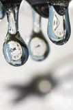 Drops of time. Play with water and clocks. Surrealistic concept Stock Photo