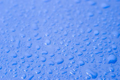 Drops of water. On a blue surface Royalty Free Stock Image