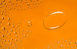 Drops of water. On an orange background Royalty Free Stock Image
