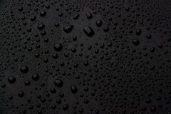 Drops of water on a black background royalty free stock photos