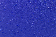 Drops of water on a blue Royalty Free Stock Photography