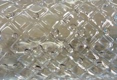 Drops of water in clear plastic bottles. Stock Photography
