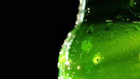 Drops of water on a cold bottle with a soft drink. To satisfy the summer thirst for a concept. 4K video Stock Images