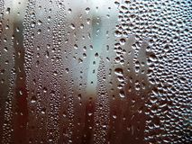 Drops of water on a cold glass. Condensate on glass royalty free stock images