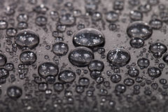 Drops of water on a color background. Gray. Shallow depth of fie Stock Photo