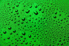 Drops of water on a color background. Green stock photo