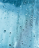Drops of water. Detail of drops of water flowing down a window royalty free stock image