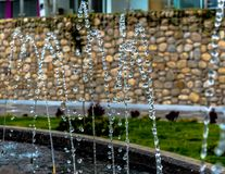 Drops of water before falling. Photograph of a fountain in a park stock photo
