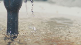 Drops of water falling into the water fountain, Sunny weather stock video