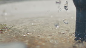 Drops of water falling into the water fountain, Sunny weather stock video footage