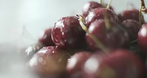 Drops of water on fresh cherry berries. Rotation around of group of ripe natural ecologic ripe red cherries berry. Rotating turntable anticlockwise. Healthy stock footage