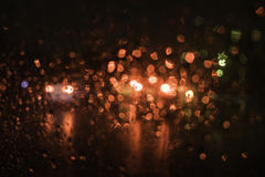 Drops of water on a glass street light. Stock Images