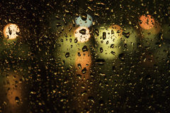 Drops of water on a glass street light. Stock Photos
